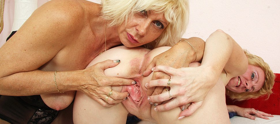 Amateur moms and Milfs licking and fingering each other